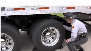 Feeling the face or crown of the tire for damage: lay hand flat on tire and slide it across the face.