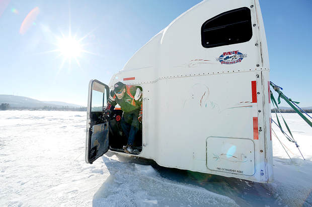 Bob Riley of Dixfield climbs out of the ice shack he made from a 1996 Freightliner tractor-trailer cab. Named Haulin' Bass, he hauled it onto Roxbury Pond in Roxbury on Jan. 1 and has been fishing out of it every weekend since.
