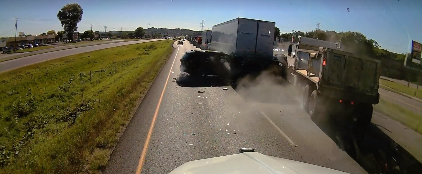 Distracted driver crashed into stopped tracffic